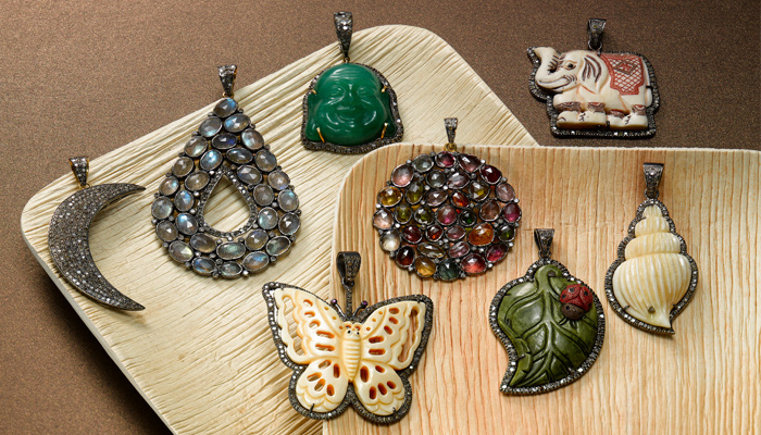 Unique pendants with carved stones, diamonds and Jade